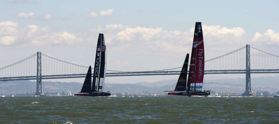 Emirates Team New Zealand (R) races down wind against Oracle Team USA during the 34th America's Cup September 22, 2013  in San Francisco. Oracle won both of the day's races. Photo: Don Emmert, AFP/Getty Images