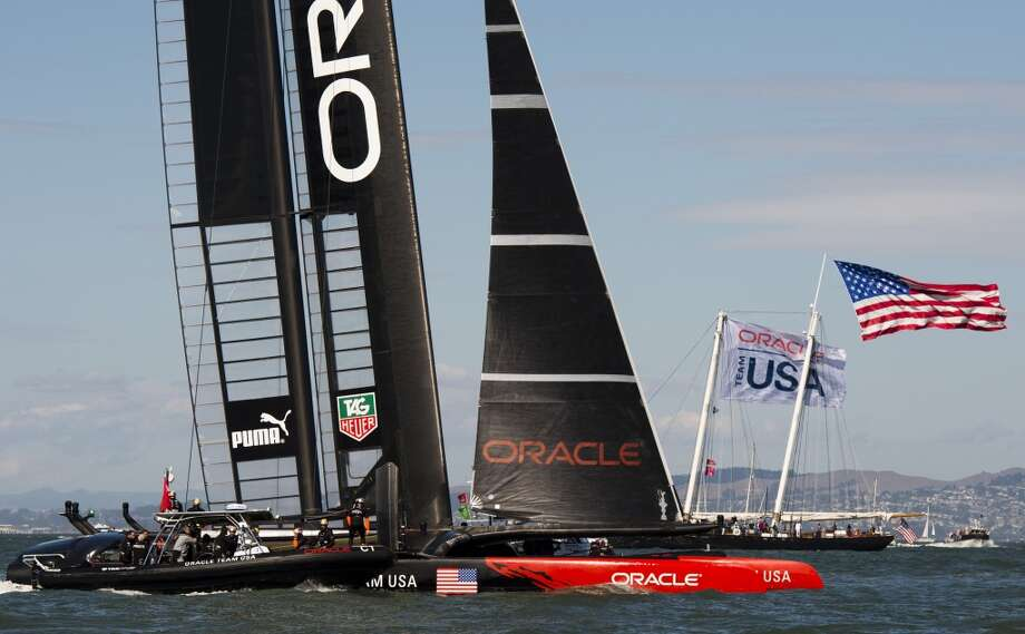 Oracle team USA passes spectator boats after winning the second race of the day during the 34th America's Cup September 22, 2013  in San Francisco. Oracle won both of the day's races. Photo: Don Emmert, AFP/Getty Images