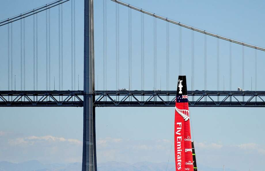 Emirates Team New Zealand makes their way toward the Bay Bridge as they sail away after being defeated in both race 14 and 15 of the 34th America's Cup on September 22, 2013 in San Francisco. Photo: Josh Edelson, AFP/Getty Images