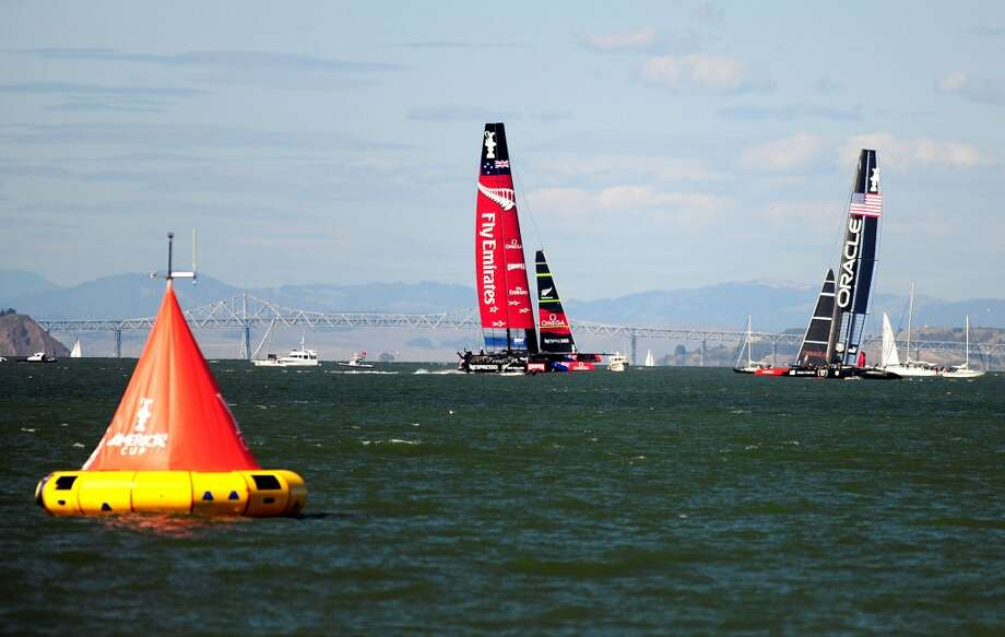 Oracle Team USA (right) maintains a lead against Emirates Team New Zealand (left) in race 15 of the 34th America's Cup on September 22, 2013 in San Francisco. Photo: Josh Edelson, AFP/Getty Images