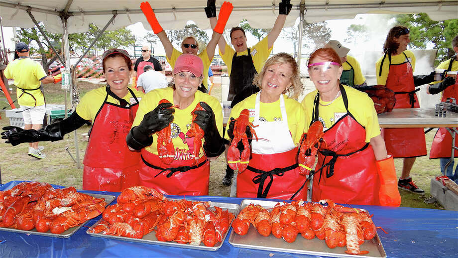 Serving up lobsters at the Westport Rotary Club's 2nd annual Lobster Fest on Saturday were: Gail Cohen, Amy Schroeder-Riggio, Rhonda Baker and Cris Megrin. Photo: Mike Lauterborn / Westport News contributed