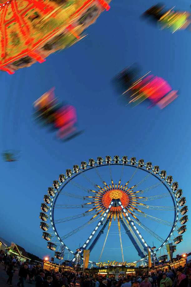 People enjoy the ride on a merry-go-round on the first day of the Oktoberfest festival in Munich, southern Germany, Saturday, Sept. 21, 2013. The world famous beer festival runs through Oct. 6, 2013. Photo: AP