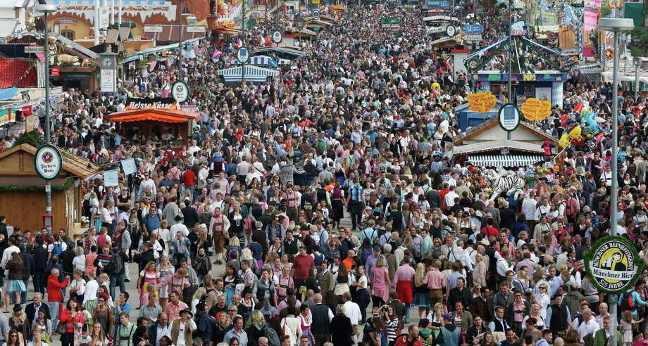 "Visitors enjoy the opening day at the Bavarian ""Oktoberfest"" beer festival in Munich, southern Germany, Saturday, Sept. 21, 2013. The world's largest beer festival, to be held from Sept. 21 to Oct. 6, 2013 will attract more than six million guests from around the world. Photo: AP"