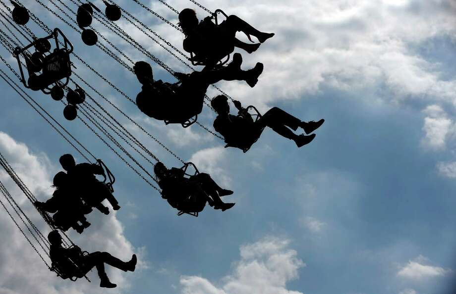"People enjoy a swing  ride at the opening day of the Bavarian ""Oktoberfest"" beer festival in Munich, southern Germany, Saturday, Sept. 21, 2013. The world's largest beer festival, to be held from Sept. 21 to Oct. 6, 2013 will attract more than six million guests from around the world. Photo: AP"