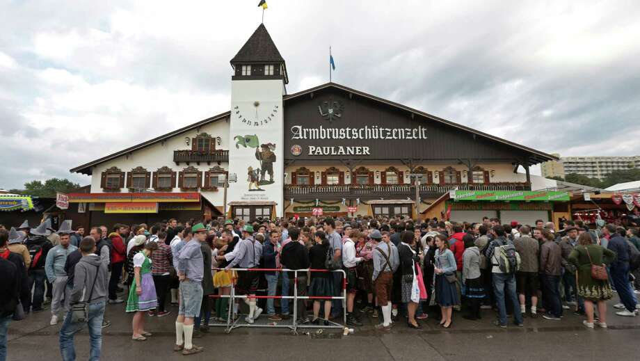 "People wait for the opening of the 180th Bavarian ""Oktoberfest"" beer festival in Munich, southern Germany, Saturday, Sept. 21, 2013. The world's largest beer festival, to be held from Sept. 21 to Oct. 6, is expected to attract more than six million guests from around the world. Photo: AP"