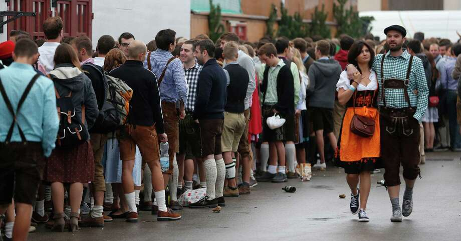 "People await the opening of the 180th Bavarian ""Oktoberfest"" beer festival in Munich, southern Germany, Saturday, Sept. 21, 2013. The world's largest beer festival, to be held from Sept. 21 to Oct. 6, 2013, is expected to attract more than six million guests from around the world. Photo: AP"
