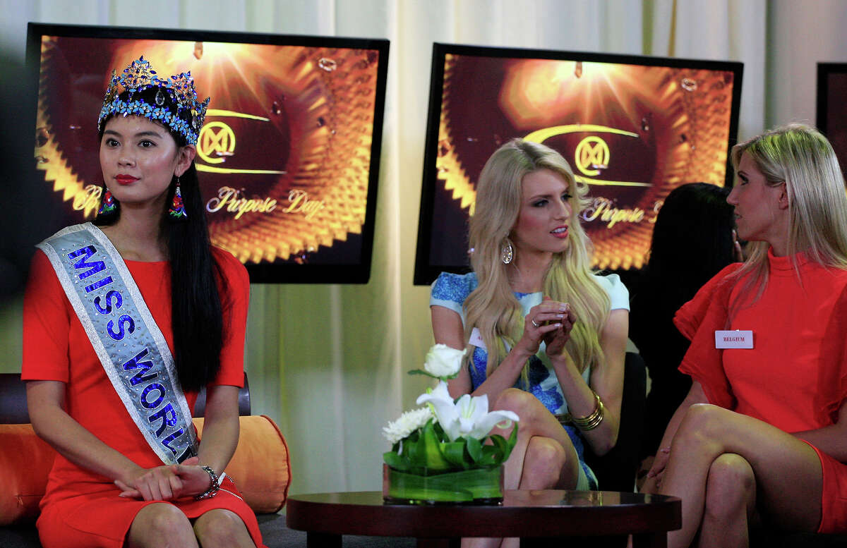 Miss World 2012 Yu Wenxia, left, of China, sits as Miss Australia Erin Holland, center, and Miss Belgium Noemie Happart chat each other during a TV show at Bali International Convention Center in Nusa Dua, Bali, Indonesia, Monday, Sept. 23, 2013. The Miss World pageant final will be held in Bali on Sept. 28.