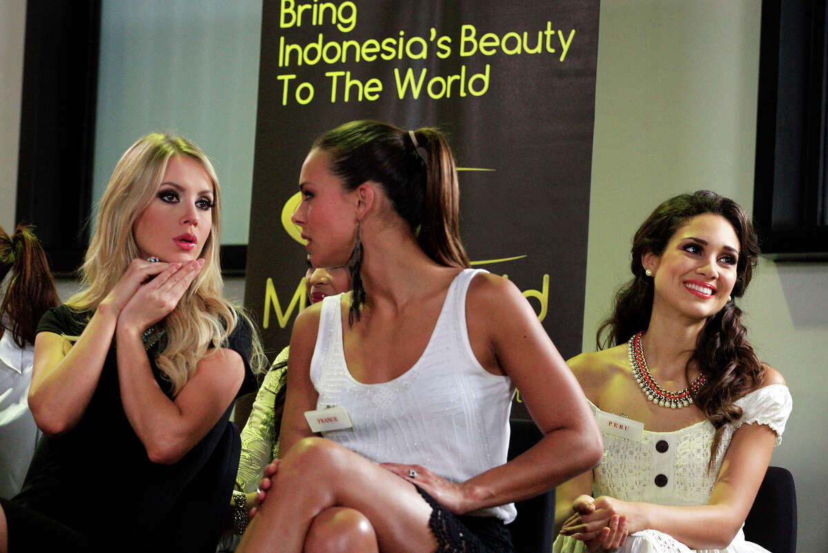 Miss Brazil Sancler Frantz Konzen, left, chats with Miss France Marine Lorphelin, center, as Miss Peru Elba Fahsbender Merino, right, smiles during a TV show at Bali International Convention Center in Nusa Dua, Bali, Indonesia, Monday, Sept. 23, 2013. The Miss World pageant final will be held in Bali on Sept. 28.