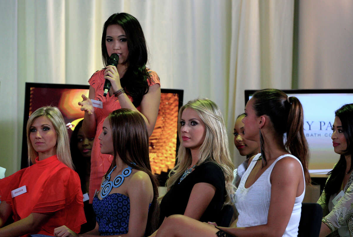 Miss Indonesia Vania Larissa speaks as other contestants, from left, Miss Belgium Noemie Happart, Miss Botswana Rosemary Keofitlhetse, Miss Brazil Sancler Frantz Konzen and Miss France Marine Lorphelin listen during a TV show beauty at Bali International Convention Center in Nusa Dua, Bali, Indonesia, Monday, Sept. 23, 2013. The Miss World pageant final will be held in Bali on Sept. 28.