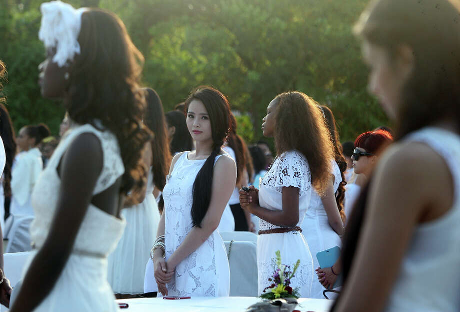 Miss World contestant, Miss Taiwan Chang Cinzia, center, stands with others during the International World Peace Day celebrations at a park in Denpasar, Bali, Indonesia on Saturday, Sept. 21, 2013. The Miss World pageant final will be held in Bali on Sept. 28. Photo: Firdia Lisnawati, AP / AP