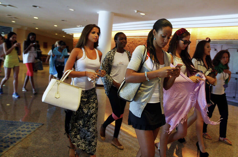 Miss World pageant contestants leave Bali International Convention Center after a rehearsal in Nusa Dua, Bali, Indonesia on Monday, Sept. 16, 2013. The 63rd edition of the Miss World pageant is currently underway as protests by Muslim hard-liners has confined the event to Indonesia's predominantly Hindu resort island of Bali. Photo: Firdia Lisnawati, ASSOCIATED PRESS / AP2013