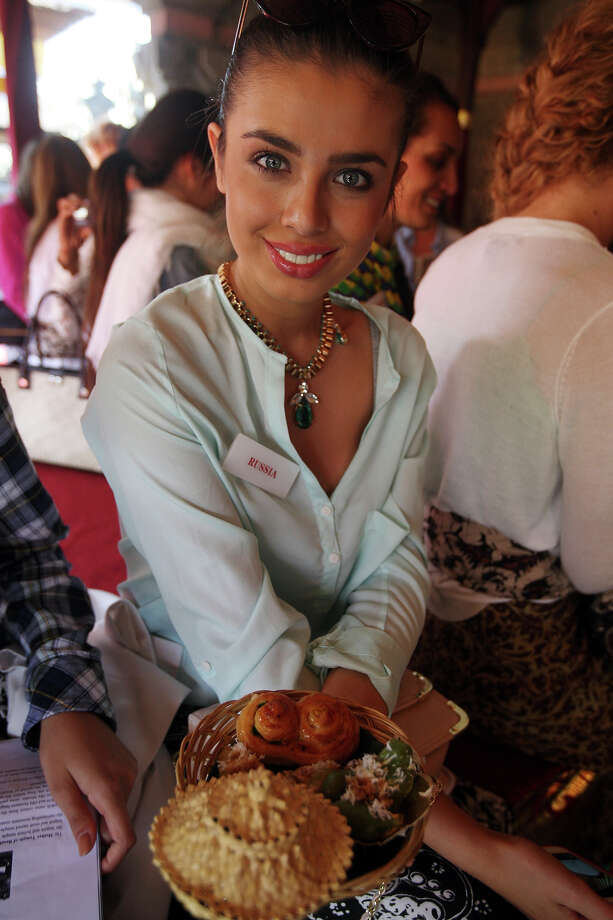 Miss World pageant contestant Miss Elmira Abdrazakova of Russia holds a basket of Indonesia food during her visit to a Hindu temple in Besakih, Bali, Indonesia Wednesday, Sept. 11, 2013. The Miss World contest will start in the resort island of Bali Sunday. (AP Photo/Firdia Lisnawati) Photo: Firdia Lisnawati, ASSOCIATED PRESS / AP2013