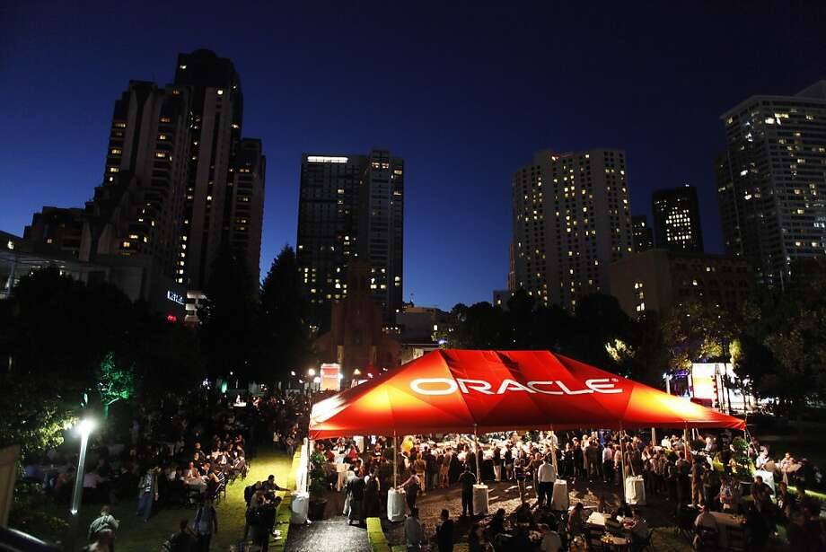 Oracle OpenWorld conference attendees flock to the Oracle Tent in Yerba Buena Gardens for a party Sunday night. Photo: James Tensuan, SFC