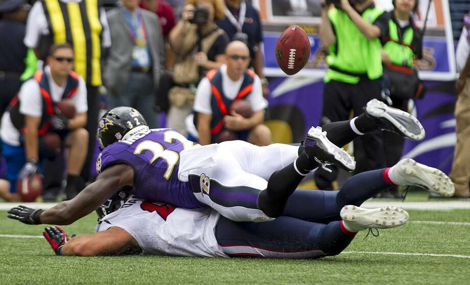 Ravens strong safety James Ihedigbo breaks up a pass intended for Texans tight end Owen Daniels during the first quarter. Photo: Brett Coomer, Houston Chronicle