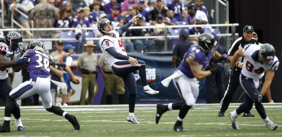 Texans punter Shane Lechler watches the flight of one of his punts against the Ravens during the second quarter. Photo: Brett Coomer, Houston Chronicle
