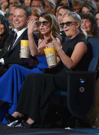 Matt Damon, Tina Fey and Amy Poehler in the audience at the 65th Primetime Emmy Awards at Nokia Theatre on Sunday Sept. 22, 2013, in Los Angeles. (Photo by Frank Micelotta/Invision for Academy of Television Arts & Sciences/AP Images) Photo: Frank Micelotta/Invision/AP
