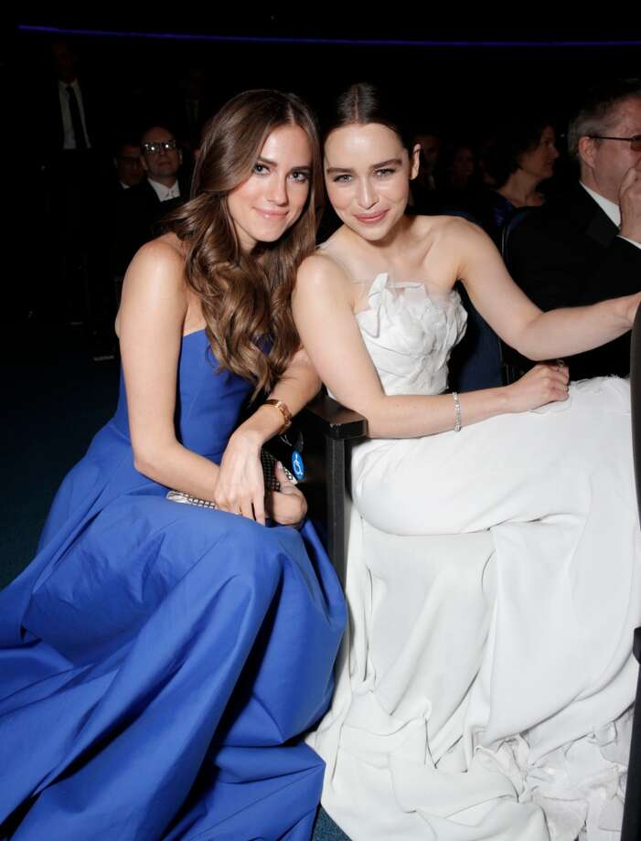 Allison Williams, left, and Emilia Clarke are seen at the 65th Primetime Emmy Awards at Nokia Theatre on Sunday Sept. 22, 2013, in Los Angeles.  (Photo by Todd Williamson/Invision for Academy of Television Arts & Sciences/AP Images) Photo: Todd Williamson/Invision/AP
