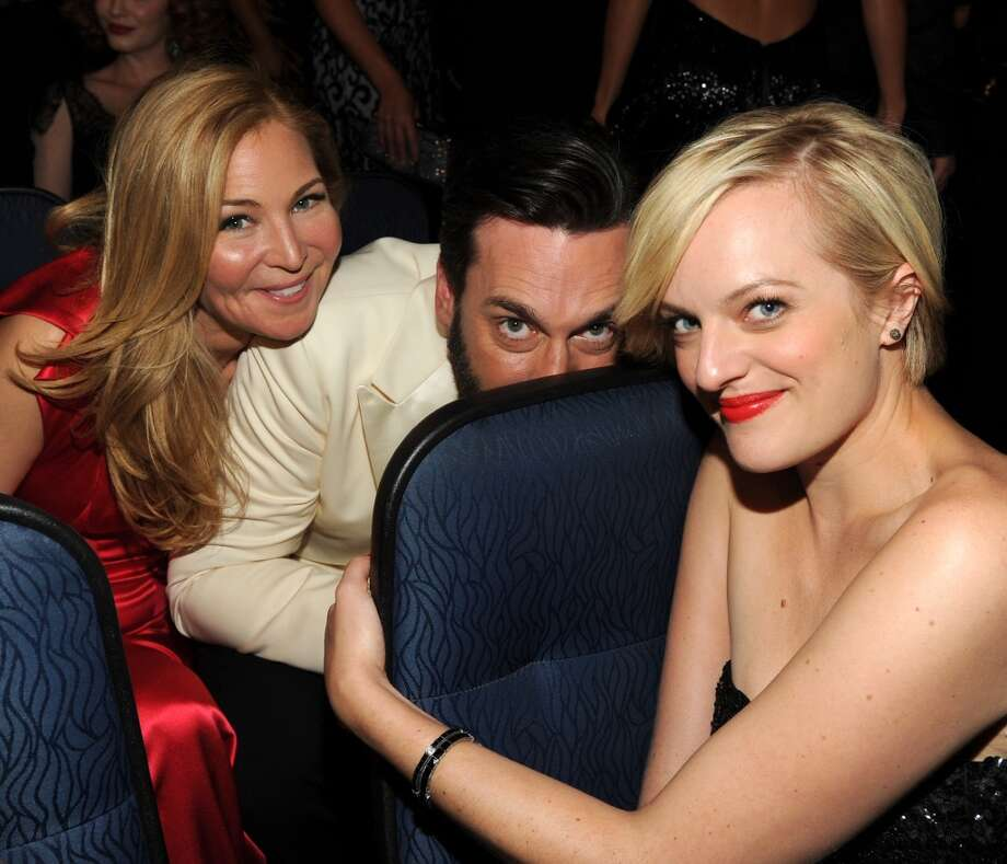 Jennifer Westfeldt, Jon Hamm and Elisabeth Moss in the audience at the 65th Primetime Emmy Awards at Nokia Theatre on Sunday Sept. 22, 2013, in Los Angeles.  (Photo by Frank Micelotta/Invision for Academy of Television Arts & Sciences/AP Images)