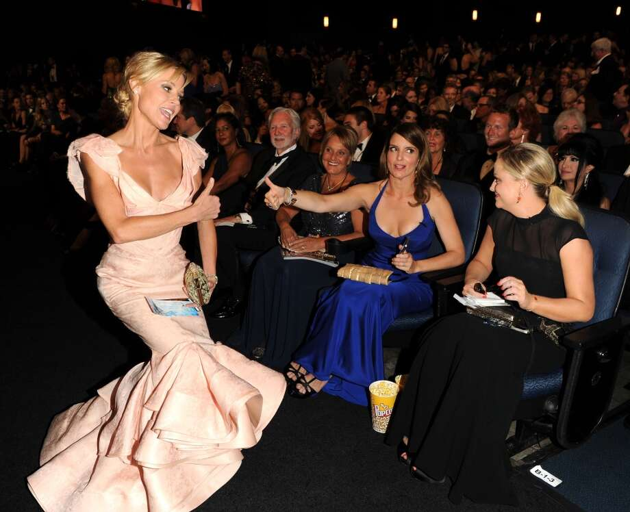 From left, Julie Bowen, TIna Fey and Amy Poehler in the audience at the 65th Primetime Emmy Awards at Nokia Theatre on Sunday Sept. 22, 2013, in Los Angeles.  (Photo by Frank Micelotta/Invision for Academy of Television Arts & Sciences/AP Images) Photo: Frank Micelotta/Invision/AP