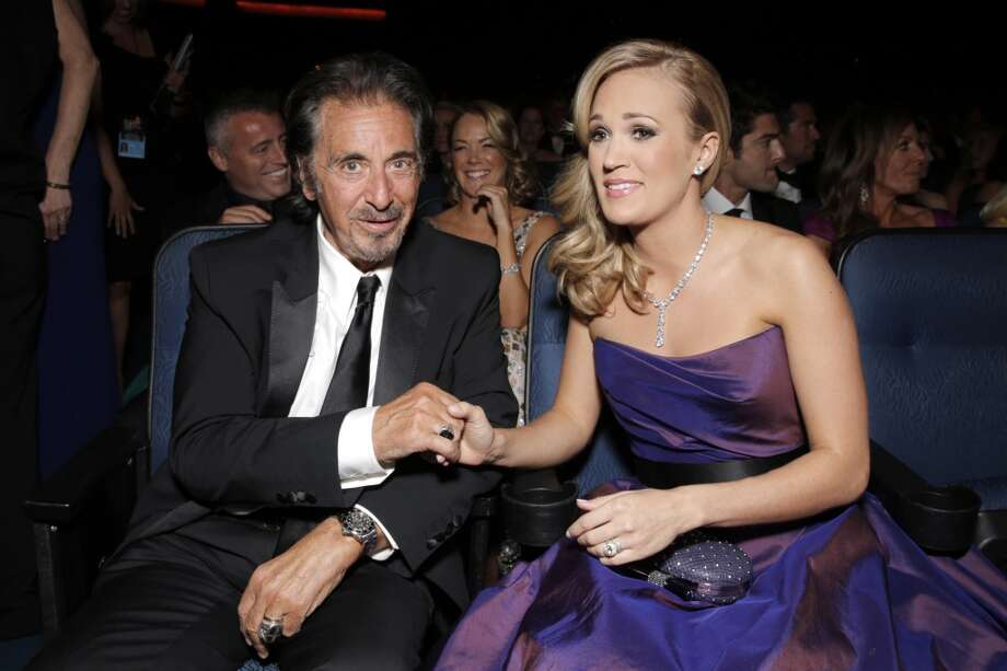 Al Pacino, left, and Carrie Underwood seen at the 65th Primetime Emmy Awards at Nokia Theatre on Sunday Sept. 22, 2013, in Los Angeles.  (Photo by Todd Williamson/Invision for Academy of Television Arts & Sciences/AP Images) Photo: Todd Williamson/Invision/AP