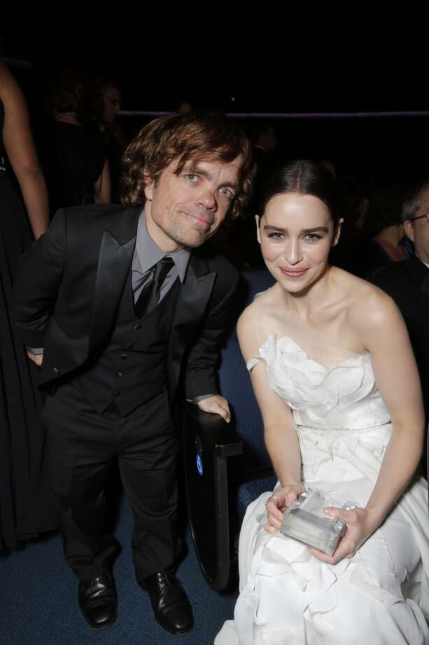 From left, Peter Dinklage and Emlia Clarke are seen at the 65th Primetime Emmy Awards at Nokia Theatre on Sunday Sept. 22, 2013, in Los Angeles.  (Photo by Todd Williamson/Invision for Academy of Television Arts & Sciences/AP Images) Photo: Todd Williamson/Invision/AP
