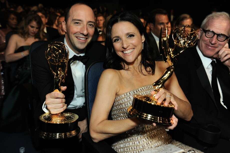 "Tony Hale, left, winner of the award for outstanding supporting actor in a comedy series, and Julia Louis-Dreyfus winner of the award for outstanding lead actress in a comedy series both for their roles on ""Veep"", are seen at the 65th Primetime Emmy Awards at Nokia Theatre on Sunday Sept. 22, 2013, in Los Angeles.  (Photo by Jordan Strauss/Invision for Academy of Television Arts & Sciences/AP Images) Photo: Jordan Strauss/Invision/AP"