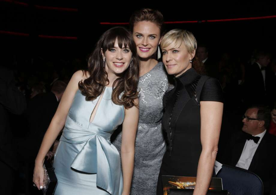 From left, Zooey Deschanel, Emily Deschanel, and Robin Wright are seen at the 65th Primetime Emmy Awards at Nokia Theatre on Sunday Sept. 22, 2013, in Los Angeles.  (Photo by Todd Williamson/Invision for Academy of Television Arts & Sciences/AP Images) Photo: Todd Williamson/Invision/AP