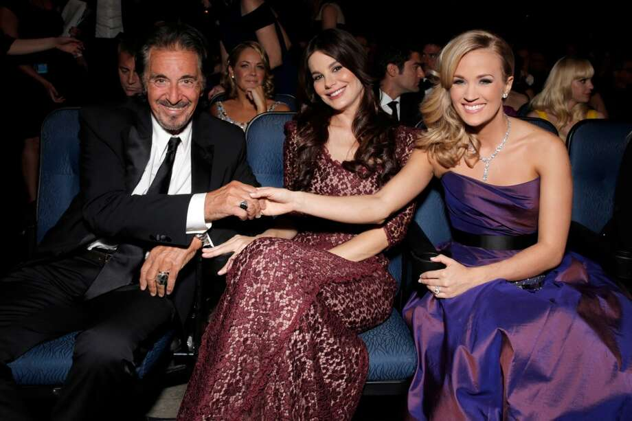 From left, Al Pacino, Lucila Sola and Carrie Underwood pose in the audience at the 65th Primetime Emmy Awards at Nokia Theatre on Sunday Sept. 22, 2013, in Los Angeles.  (Photo by Todd Williamson/Invision for Academy of Television Arts & Sciences/AP Images) Photo: Todd Williamson/Invision/AP