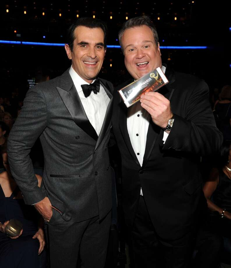 From left, Ty Burrell and Eric Stonestreet in the audience at the 65th Primetime Emmy Awards at Nokia Theatre on Sunday Sept. 22, 2013, in Los Angeles.  (Photo by Frank Micelotta/Invision for Academy of Television Arts & Sciences/AP Images) Photo: Frank Micelotta/Invision/AP