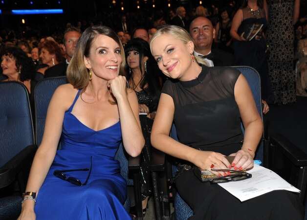 Tina Fey and Amy Poehler in the audience at the 65th Primetime Emmy Awards at Nokia Theatre on Sunday Sept. 22, 2013, in Los Angeles. (Photo by John Shearer/Invision for Academy of Television Arts & Sciences/AP Images)