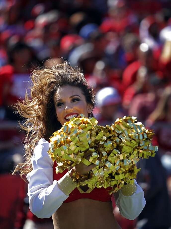 A 49ers's Gold Rush dancer cheers for the team in the third quarter. The San Francisco 49ers played the Indianapolis Colts at Candlestick Park in San Francisco, Calif., on Sunday, September 22, 2013. The 49ers lost to the Colts 27-7. Photo: Carlos Avila Gonzalez, The Chronicle