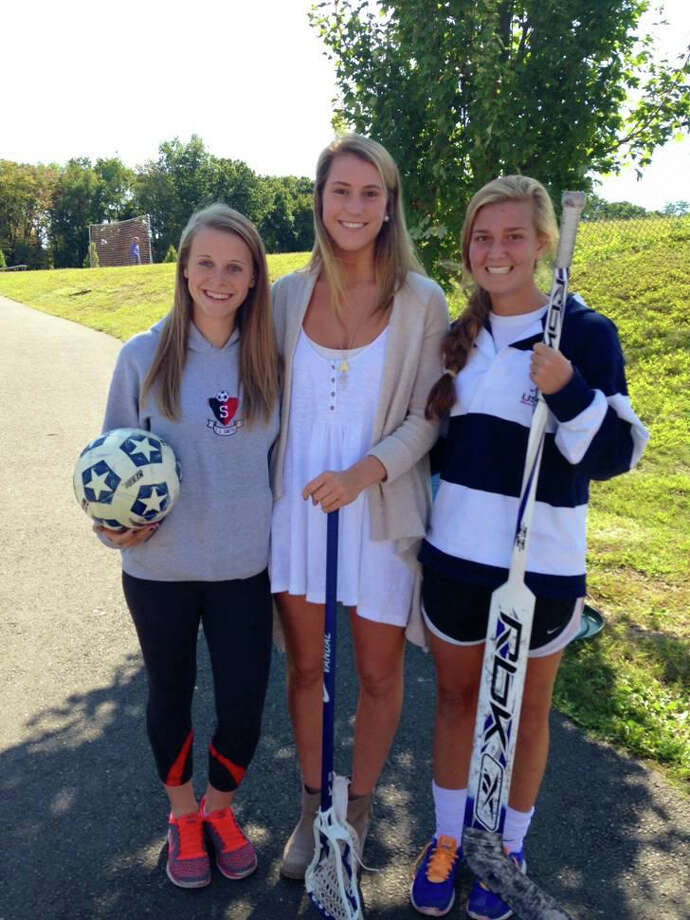 The Captains of the Darien girls hockey team for the 2013-14 season: From left, Sage Thacher, Ellie Bennett and Shannon Hall. Photo: Contributed Photo