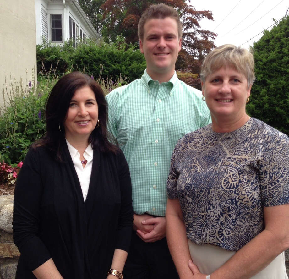 MBA intern George Thomassy received hands-on experience at HTG Investment Advisors of New Canaan. With him are office manager Susannah Hansley, left, and Robin Sherwood, principal at HTG Investment Advisors. Photo: Contributed