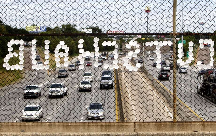 "A fence holds cups spelling ""Cut Schaub"" on the North St. Bridge over I-45 on Monday. Photo: Cody Duty, Houston Chronicle"