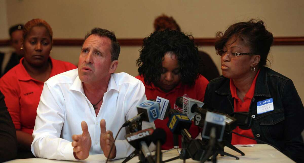 Neil Heslin, father of Sandy Hook victim Jesse Lewis, left, speaks next Jackie Pettway, right, at a roundtable discussion to talk about next steps in the fight against gun violence at Bridgeport City Hall on Monday, Sept. 23, 2013. Pettway lost her son, LaChristopher, to gun violence in Bridgeport this month. U.S. Senators Richard Blumenthal and Chris Murphy, Congressman Jim Himes, Mayor Bill Finch, and Assistant Police Chief James Nardozzi lead the discussion.