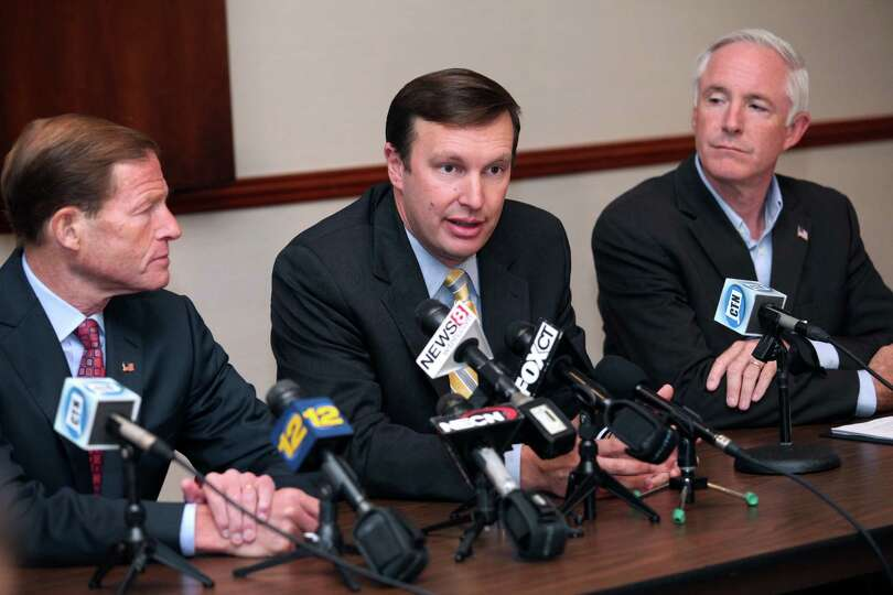 U.S. Senators Richard Blumenthal, left, and Chris Murphy, and Mayor Bill Finch, right,  speak at a r