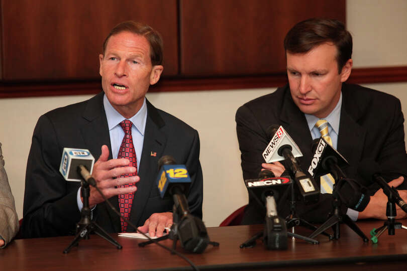 U.S. Senators Richard Blumenthal, left, and Chris Murphy,  speak at a roundtable discussion regardin