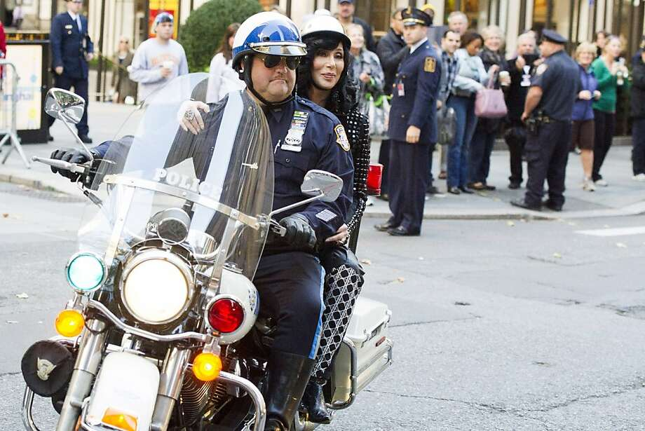 "Ridin' with the queen: Cher arrives by police motorcycle for her performance on NBC's ""Today"" show in New York. Photo: Charles Sykes, Associated Press"