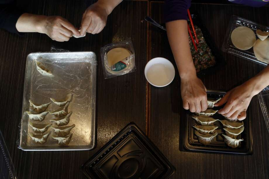Lily Fang, left, and Kathy Fang, right, make dumplings at their restaurant. Photo: Ian C. Bates, The Chronicle