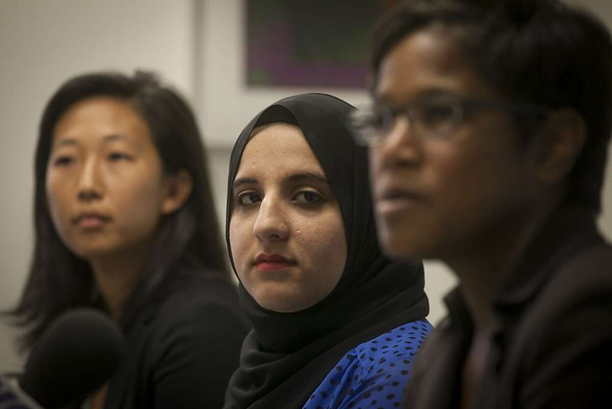 From left to right, Marsha Chien, a Legal Aid Society Skadden Fellow, Hani Khan and Marcia Mitchell, a Senior trial Attorney, during a press conference announcing the settlement from a three year lawsuit against Abercrombie & Fitch on September 23rd 2013 held at the Legal Aid Society Employment Law Center in downtown San Francisco. Hani Khan was fired in 2010 from Abercrombie after refusing to take off her head scarf in accordance with the companies