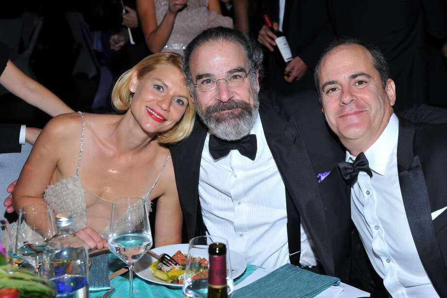 Claire Danes, Mandy Patinkin, and Showtime president David Nevins are seen at the Governors Ball after the 65th Primetime Emmy Awards at Nokia Theatre on Sunday Sept. 22, 2013, in Los Angeles. (Photo by Vince Bucci/Invision for Academy of Television Arts & Sciences/AP Images) Photo: Vince Bucci, Vince Bucci/Invision/AP
