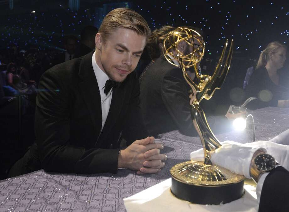 Exclusive - Derek Hough is seen at the Governors Ball at the 65th Primetime Emmy Awards at Nokia Theatre on Sunday Sept. 22, 2013, in Los Angeles.  (Photo by Phil McCarten/Invision for Academy of Television Arts & Sciences/AP Images) Photo: Phil McCarten, Phil McCarten/Invision/AP