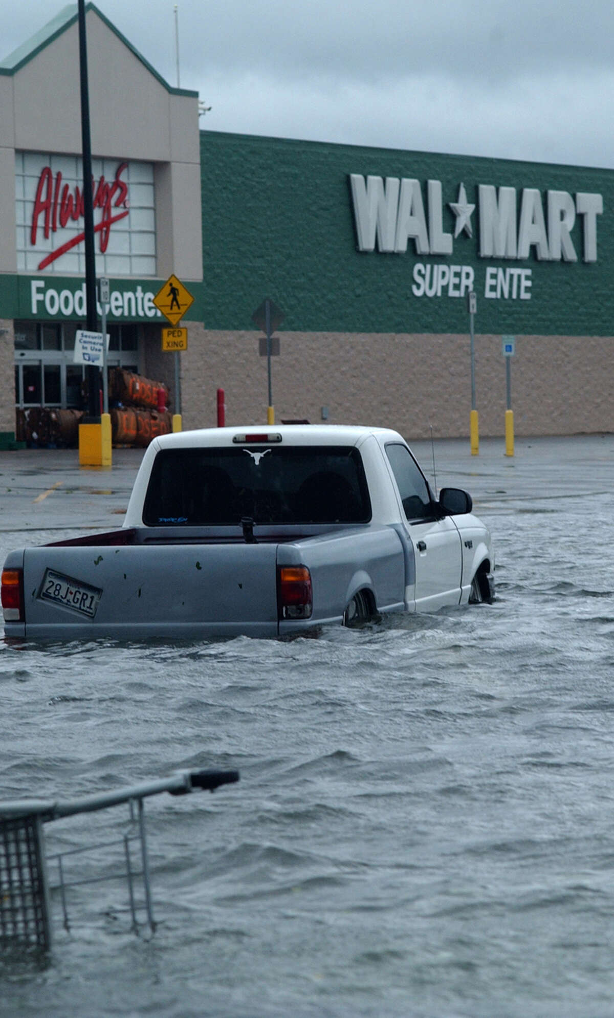 Storm water stands 2- and 3-feet deep in the parking lot of the Silsbee Wal-Mart Saturday.(AP PHOTO/THE BEAUMONT ENTERPRISE, RON FRANCELL)