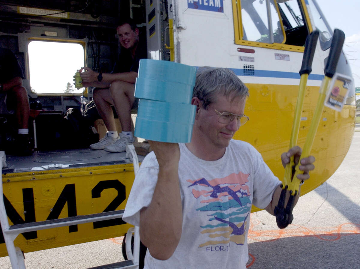 Matt Frentress, a crew chief aboard an AT&T Disaster Recovery Helicopter, offloaded supplies at the AT&T building in Beaumont, to help reinforce the building and its equipment before Hurricane Rita arrived.