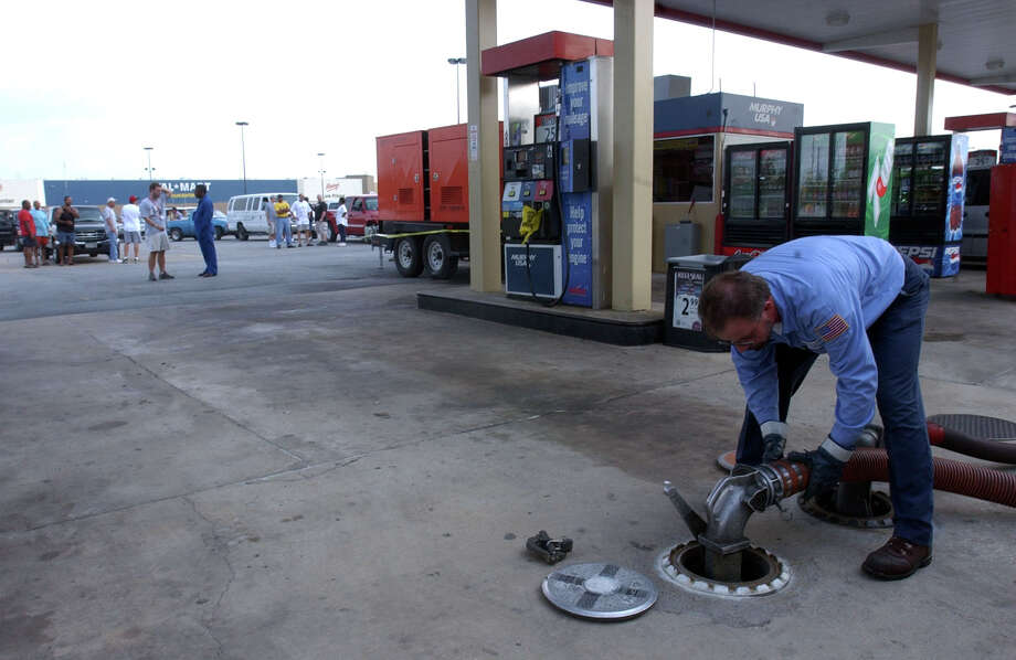 Slovek Lomoc filled up the storage tanks at a Beaumont Walmart on Sept. 26, 2005, a couple days after Hurricane Rita made landfall. Hundreds of evacuees ran out of gas while using overcrowded roads to escape. Many stations ran out of fuel. Photo: Beaumont Enterprise / The Beaumont Enterprise