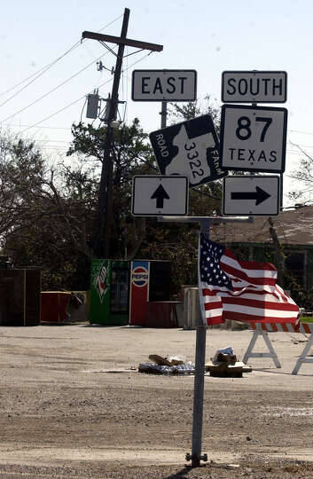 A flag flies from the highway signs at the 4-way stop Wednesday in Sabine Pass.  Photo/Jennifer Reyn