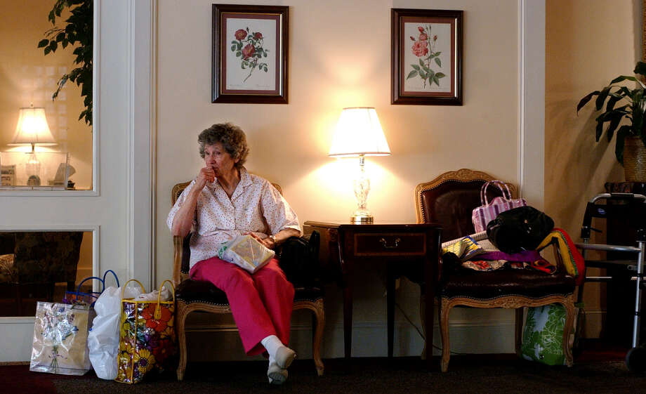 Ruby Roche, 79, waited on her daughter during an evacuation at The Ridgewood Retirement Community in Beaumont on Sept. 21, 2005. She planned to meet with her other daughter in Dayton to determine where the family would eventually go during Hurricane Rita. Photo: Beaumont Enterprise