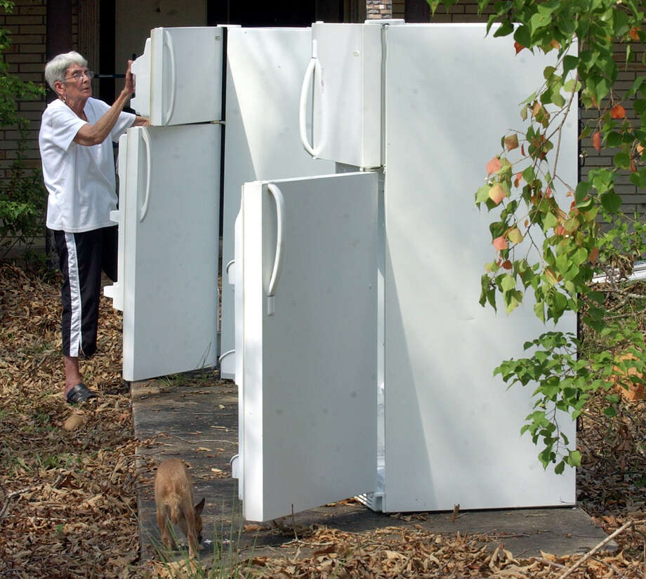 Willa D. Coe, 77, cleaned out her refridgerators in front of her Kountze a few days after Hurricane Rita tore through Southeast Texas. FEMA records show Texans requested or were paid for more than 6,400 refrigerators through the agency's individual assistance program through December 2005.  Photo: Beaumont Enterprise / Beaumont