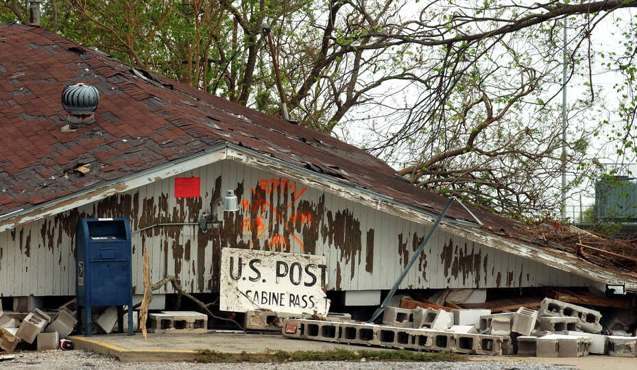 The Sabine Pass Post Office remains destroyed in Sabine Pass on Saturday, October 8, 2005. Hurricane