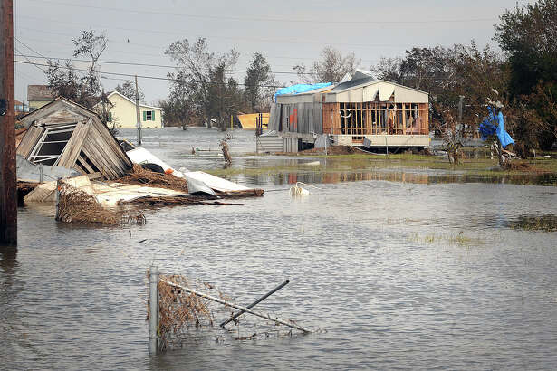 After Hurricane Rita tore through Sabine Pass, citizens were required to rebuild homes twelve feet above sea level to receive assists. Those homes still at ground level were devastated by Hurricane Ike. Guiseppe Barranco/The Enterprise
